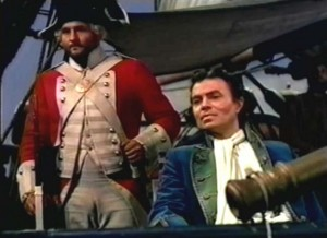 The pleasure of entertainment: Gilbert watching the keelhauling with a surveilling eye. Digital frame enlargement.